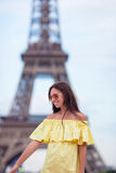 Young woman background Eiffel Tower in Paris Stock Photography