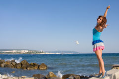 Young woman on the background of the sea Royalty Free Stock Photography