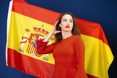 Young woman on the background of the Spanish flag Stock Photo