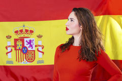 Young woman on the background of the Spanish flag Stock Photography