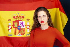 Young woman on the background of the Spanish flag Royalty Free Stock Images