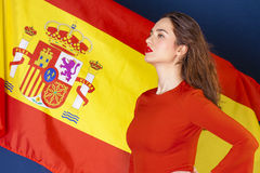 Young woman on the background of the Spanish flag Royalty Free Stock Photography