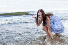 Young woman on background waves Royalty Free Stock Photos