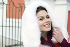 Young woman on the background of a winter city Royalty Free Stock Images