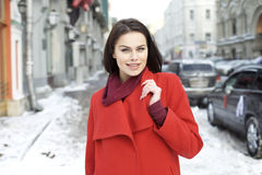Young woman on the background of a winter city Royalty Free Stock Photo