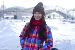 Young woman on the background of a winter city Stock Photo