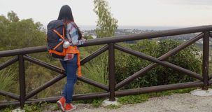 Young woman with a backpack admiring the scenery Royalty Free Stock Photo