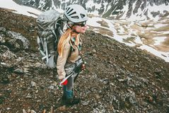 Young woman with backpack climbing in mountains Stock Photography