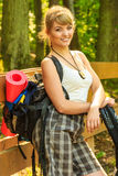 Young woman with backpack hiking in forest trail Royalty Free Stock Photography