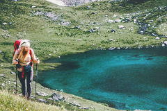 Young Woman with backpack hiking at mountains lake Stock Photography