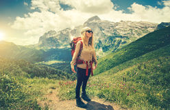 Young Woman with backpack hiking Travel Lifestyle Stock Photo