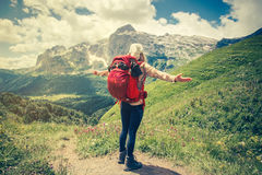 Young Woman with backpack hiking Travel Lifestyle Stock Photos