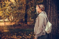 Young woman walking through the park Royalty Free Stock Image