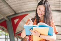 Young woman with backpack hold notebook Stock Image