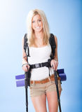 Young woman with backpack and jogging sticks Stock Photography