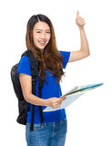 Young woman with backpack, map and thumb up Royalty Free Stock Photography