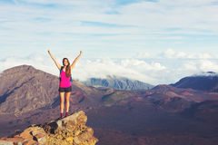 Young Woman with Backpack on Mountain Peak with Open Arms Stock Images