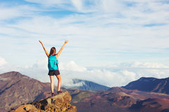 Young Woman with Backpack on Mountain Peak with Open Arms Stock Image