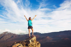 Young Woman with Backpack on Mountain Peak with Open Arms Stock Photography