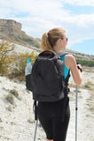 Young woman with backpack in mountains Royalty Free Stock Images