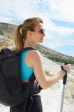 Young woman with backpack in mountains Stock Image