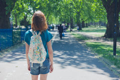 Young woman with backpack in park Royalty Free Stock Image