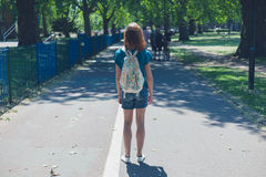 Young woman with backpack in park Royalty Free Stock Photo