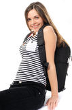 Young woman with a backpack, smiles Royalty Free Stock Image