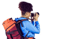 Young woman with backpack taking picture Royalty Free Stock Photography