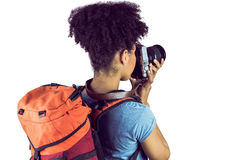Young woman with backpack taking picture Royalty Free Stock Photo