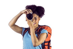 Young woman with backpack taking picture Stock Photography