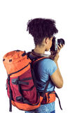 Young woman with backpack taking picture Stock Photo