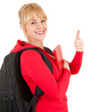 Young woman with backpack and thumb up Royalty Free Stock Photography