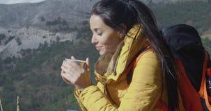 Young woman backpacker enjoying coffee stock video