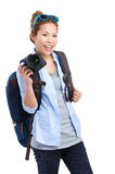 Young woman backpacker holding camera Stock Image