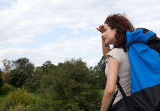 Young woman backpacker looking away Stock Photo