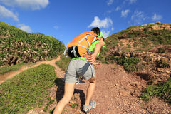 Young woman backpacker walking Royalty Free Stock Photo
