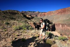 Young woman backpacking in the Grand Canyon. royalty free stock photography