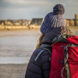 Young Woman Backpacking, Scotland. Girl Journeys to the Coast of Scotland Stock Photography