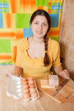 Young woman with bacon and eggs Stock Photo
