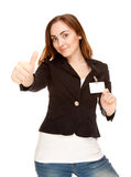 Young woman with badge (focus on hand) Royalty Free Stock Image