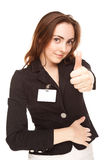 Young woman with badge (focus on hand) Stock Images