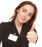 Young woman with badge (focus on hand) Royalty Free Stock Photography