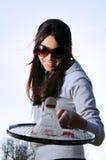 Young woman with badminton racquet Stock Photos