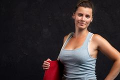 Young woman with bag posing in studio on black background royalty free stock photo