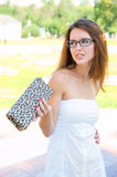 Young woman with bag in white dress Royalty Free Stock Photography