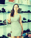 Young woman with bags  in shoes store Stock Photography