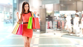 Young woman with bags in shopping mall Stock Photography