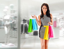 Young woman with bags in shopping mall Stock Image