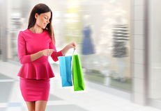 Young woman with bags in shopping mall Royalty Free Stock Images
